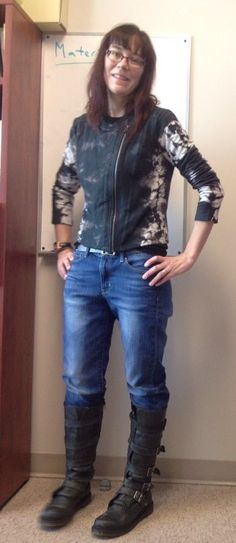 Tall, stompy, buckle boots, blue jeans and interesting knit moto.