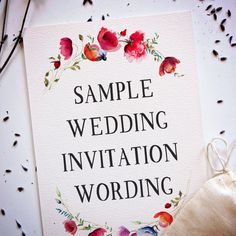 """A card with watercolor flowers that reads """"Sample Wedding Invitation Wording"""""""