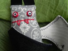Small sewn cute bat with red  fangs and evil eyes by thatvoodoo