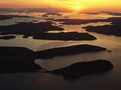 San Juan Islands, Washington  Photograph by Phil Schermeister, National Geographic    Summer in Washington's San Juan Islands is all about the weather, whales, and water. The Olympic Peninsula's rain shadow effect (basically, the mountains block rain-producing weather systems) produces dry, clear, comfortable days on the archipelago's four named islands—San Juan, Orcas, Lopez, and Shaw. Hike in Lime Kiln Point State Park on the west side of San Juan for shore-based orca watching..