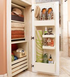Creative Linen Closet For added convenience, a linen closet was built into the corner wall space between the vanity and the walk-in shower. Inside, shelves accommodate towels and labeled baskets of workout clothes. A storage cube on wheels slides out to allow easy access to yoga blocks. Hooks and shallow compartments, hanging from pegboard mounted to the back of the closet door, store small items.