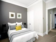 White walls with dark grey feature wall for the Hall