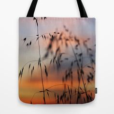 Dream sunset at the field. Tote Bag by Guido Montañés - $22.00