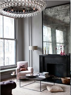 I LOVE the old oversized mirror and the soft grey and pink shades. ©Ditte Isager