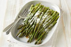 Grilled Asparagus recipe - Fresh asparagus spears are dressed in balsamic vinaigrette and grated Parmesan and grilled till crisp-tender in this simple yet elegant side.