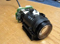 Mate a 20x zoom lens to a webcam board.  Will still need to figure out how to use arduino and possibly a motor board (EasyDriver?) to control zoom and focus.
