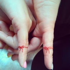 A red string around the finger used to be an old-timey way to remember something. Now you can think about each other all the time, permanently. | 24 Cherishable Best Friend Tattoos