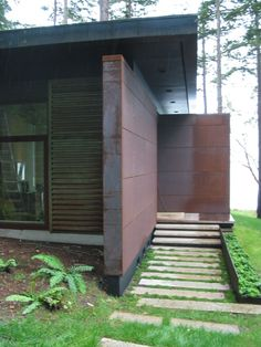 Exterior Material -  steel cor-ten panels. The panels develop a layer of rust which continues to weather over time but protects the inner layers of the panel.
