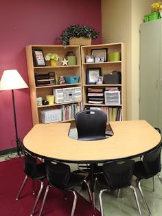 I love how this teacher doesn't have a teacher desk but her teacher supplies are on a shelf behind her small group area. It eliminates the problem of a messy desktop because you need the table for group time and you can easily see and reach all your supplies.