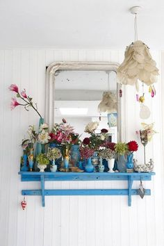 Collect tiny vases in similar colours from charity shops and car-boot sales and display on a shelf in your hallway. What could be more welcoming when coming home after a long, hard day?