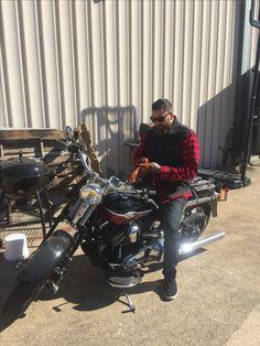 Luke Wessman on Oliver Peck's springer. Harley Motorcycle