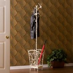 @Overstock - An antique white finish and umbrella stand highlight this hall tree. The hall tree also features a nature inspired style with a distressed finish to add character.http://www.overstock.com/Home-Garden/Abbey-Antique-White-Hall-Tree/5482371/product.html?CID=214117 $94.99
