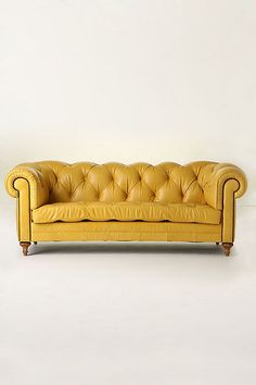 Great looking in this color but I prefer no buttons on single cushions.. I don't like to sit on buttons, do you? :-) Atelier Chesterfield - Anthropologie.com