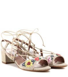 Tabitha Simmons - Lori Meadow embroidered sandals - Tabitha Simmons' 'Lori Meadow' sandals epitomise everything we love about warm-weather style – pretty florals, natural fabrics and strappy silhouettes. These canvas sandals are embroidered with multicoloured flowers on the front for a pop of pretty colour. Wear yours with a white cotton dress – the modest heel will elevate your look. seen @ www.mytheresa.com