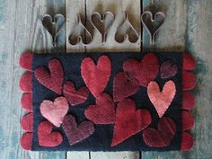 "Wool Crazy ~ Scattered Hearts made by Patti Gagliardi from the pattern in ""Primitive Quilts and Projects"" by Jo Ann Mullaly from San Diego, Calif. Jo Ann retired in Wool Applique Patterns, Felt Applique, Valentine Crafts, Valentines, Christmas Crafts, Felted Wool Crafts, Wool Quilts, Wool Art, Penny Rugs"