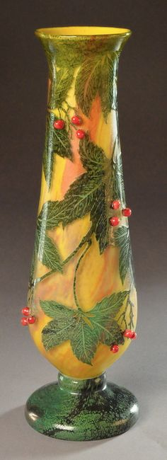 DAUM cameo glass vase with applied red berries. The Virginia creeper leaves, originally in vitrified powders, are etched on a yellow-orange background and then wheel-carved. Signed in intaglio «Daum Nancy» with the cross of Lorraine. Circa 1905. 15 in. (38 cm) high.  |  SOLD 6,000 EUR
