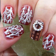 Christmas Decorations nail art of icicle lights over a red brick background and a wreath nail charm over a stamped wooden door.