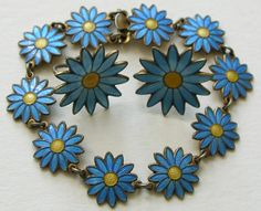 Aksel Holmsen Enameled Daisy Sterling Bracelet and Earrings  This fun vintage (circa 1950) demi-parure features enameled blue daisies with yellow centers
