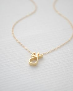 Personalized lowercase cursive necklace by Olive Yew. www.oliveyew.com