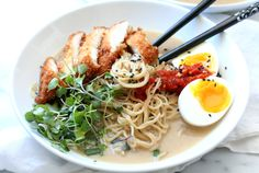This easy miso ramen topped with chicken katsu is delicious and simple. Top it with a 6 minute soft boiled egg, micro radish greens and sambal chili paste.