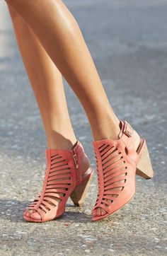 Vince Camuto's gorgeous coral wedge sandals add a bright pop of color to your summer outfit!