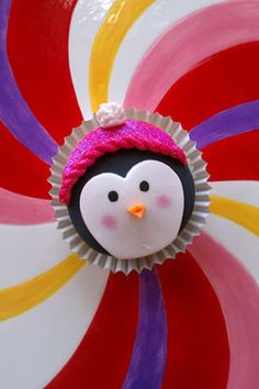 penguin all bundled up in a sparkly pink hat cupcake