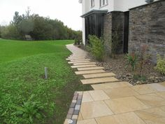 A Stunning example of what you can achieve with our Yellow Granite Paving