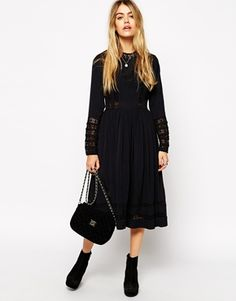 Attractive black net dress for summer with sweet black bag and shoes combination. Special outfit for special people.more..