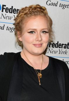 "Of that signature makeup look, Adele tells Rolling Stone it's ""borderline drag."""
