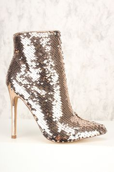 Rock these booties this holiday season with a bodycon dress. The featuring includes a versatile sequins pattern, pointy close toe, inner zipper closure followed by a cushion foot-bed. Approximately 4 inch heel.