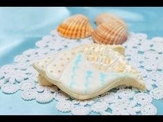 In this video I show you how to decorate conch sea shell cookies, using brushed embroidery and wet on wet technique. Also included is painting with luster dust. You also view tutorial on my blog
