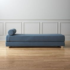 Shop lubi blue daybed sleeper.   Analyst-style lounge by day, dreamy guest bed by night.  Easily adapts to host one or two overnighters: Stacked double mattress sleeps twin.  Or, remove the top to side-by-side on the floor for an oversized queen.