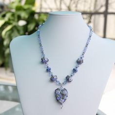 Blue and lavender flowered heart lampwork necklace $129.00