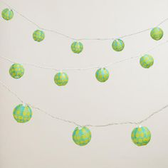 One of my favorite have lots of outdoor lighting for dining, pathways, just hanging out: at WorldMarket.com: Aqua and Green Dots Paper String Lights