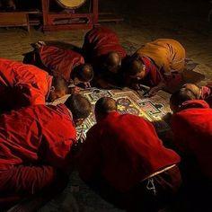Buddhist monks working on a sand mandala