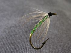 150)-Green-Midge, Tag and Rib, gold tinsel, Body, green floss, Hackle, light blue dun.