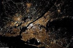 The city that never sleeps: Mr Hadfield, the flight engineer on Expedition 34 of the International Space Station tweeted this image of the shining lights of New York City at night from his perch on board the International Space Station