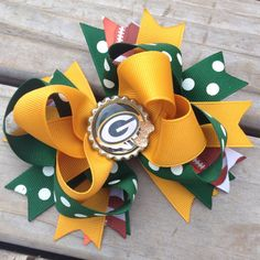 Football hair bow baby girl Greenbay packer by MonkeyToesHairBows