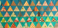 2-part tutorial on making an equilateral triangle quilt fairly easily.