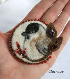 needle felted bird brooch with beaded embellishments