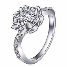 """Platinum-Plated Sterling Silver Cubic Zirconia Three-Row Pave Round Cut Women's Ring Size 8. Plant symbol:Snow lotus on behalf of Love, Tough, Pure, To bring hope, Holy symbol. High Quality Healthy Sterling Silver """"Silver content greater than 92.5%"""", Hypoallergenic and Free of Lead and Nickel. The outer cover Platinum, do not fade, no oxidation, forever lasting shine!. Come with a Ubei jewelry Box and Gray Velvet Pouch. Ensure safe transport without damage and Nice. Promise Offer 90-day…"""