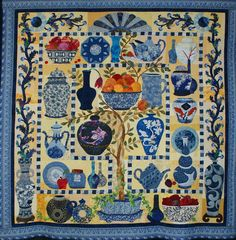 "1217-BlueVases.jpg - 1217Marilyn Yeakey - Blue Vases -- Appliquéd Quilt - 2 or more persons. Judged. 63x66"". Hand Appliquéd, 2009. Machine quilted by Denise Green. Blue Vases by Maggie Walker Designs. This was a fascinating quilt to make. Maggie Walker is a genius with her wonderful designs. I enjoyed all the gorgeous batiks."