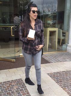 Keeping watch on the kids: Kourtney Kardashian looked like any other harried mom as she hi...