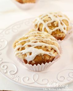 Pumpkin Muffins with a Cinnamon Streussel Crumb Topping and a simple frosting. Yum and perfect for fall. #lmldfood