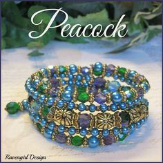 PEACOCK Beaded 5x Multi Strand Memory Wire Bracelet ~ This gorgeous 5x beaded wrap bracelet is made with stainless steel memory wire that adjusts to the size of your wrist. Fits 6 to 8 wrists. There are 3 beaded rows with sparkling Czech Crystals in Purple Aurora, Aqua and Emerald