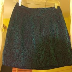 Silence + Noise metallic Blue skirt size 4 The cutest skirt I ever bought at buffalo exchange but I'm a size 0-2 and it doesn't fit me! The Color is a subdued teal-ish electric blue which is slightly metallic. The patter. Is either black or navy. This skirt, I can tell has been washed a few times, but is in good shape other than a little fading. Let me know if you have any questions! silence + noise Skirts