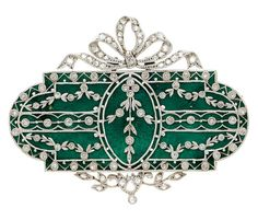 Diamond, Enamel, Platinum-Topped Gold Brooch The brooch features rose-cut diamonds weighing a total of approximately 0.25 carat, enhanced by green enamel, set in an openwork design in platinum-topped 18k gold, completed by a pinstem and catch on the reverse. Gross weight 10.40 grams. Edwardian or Edwardian style.