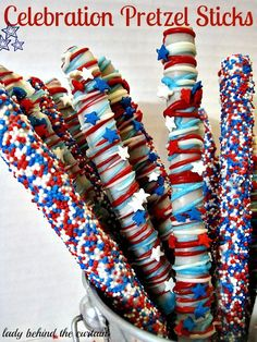 Patriotic Party Treats - DIY Red, White   and Blue Celebration Pretzel Sticks with instructions from Lady Behind The   Curtain