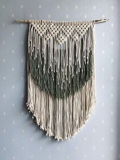 The original two-color macrame wall hanging is ideal for a stylish interior of a living room or bedroom. The original knots looks like snowflakes or flowers depending on the time of year. Im sure that this wall hanging can become a stylish thing for the bedroom. The item is made of