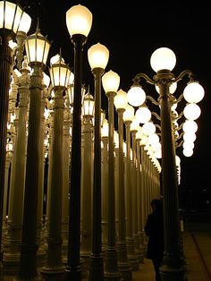 Street lamp installations light up the night at the Los Angeles County Museum of Art.